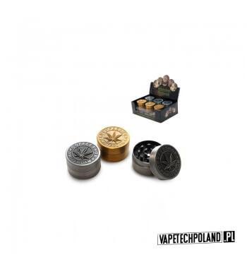 Grinder/Młynek do tytoniu - Amsterdam Metalowy młynek do tytoniu.Wysokość 2,5 cm.Średnica 4 cm. 1
