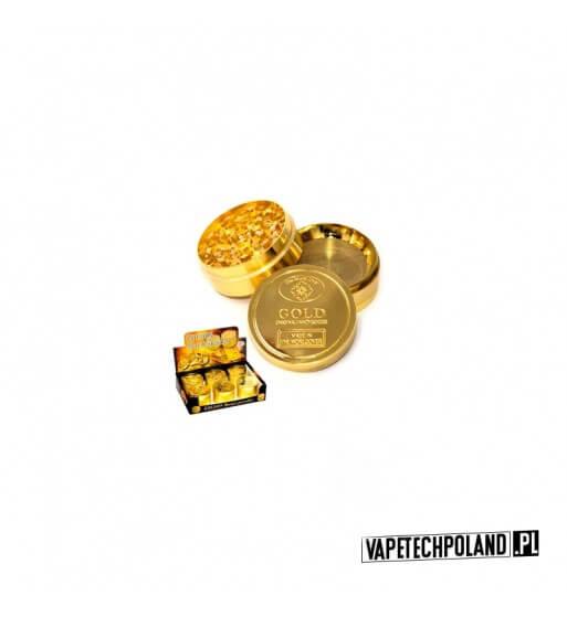 Grinder/Młynek do tytoniu - Gold Metalowy młynek do tytoniu. Olśniewający, złoty kolor.Wysokość 3,5 cm.Średnica 5 cm. 1
