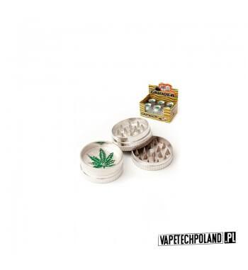 Grinder/Młynek do tytoniu - Liść Metalowy młynek do tytoniu z zawsze modnym motywem listka. Wysokość 2 cm. Średnica 4 cm. 1